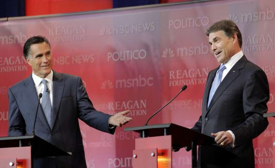 Fingers wagged as Romney and Rick Perry clashed during the primary debates. (Jae C. Hong / AP)