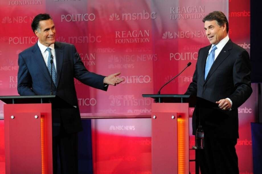 Rick Perry was harshly critical of Mitt Romney during the primary season. (Getty Images)