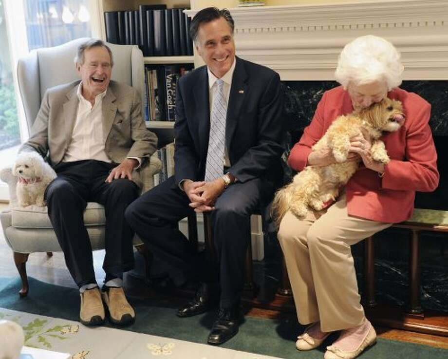 Then-presidential candidate Mitt Romney, visits with the Bushes in Houston on Dec. 1, 2011.