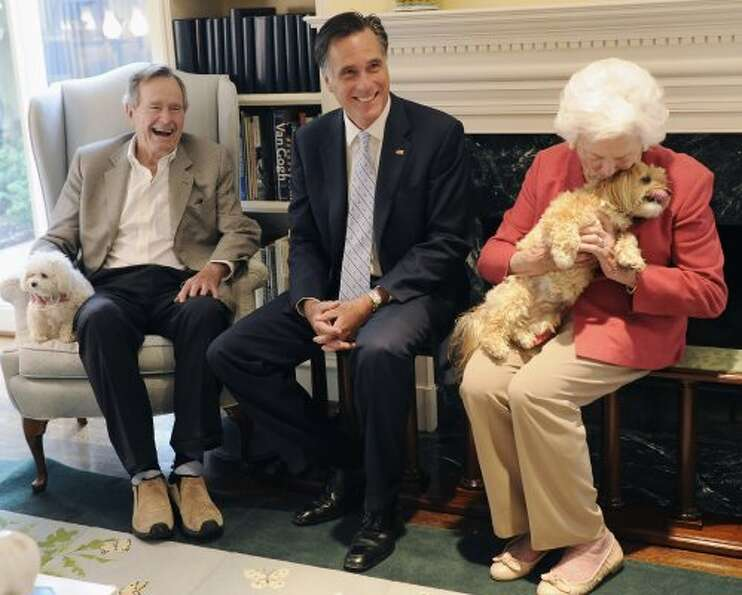 Mitt Romney accepts the support of George and Barbara Bush in Houston (AP)