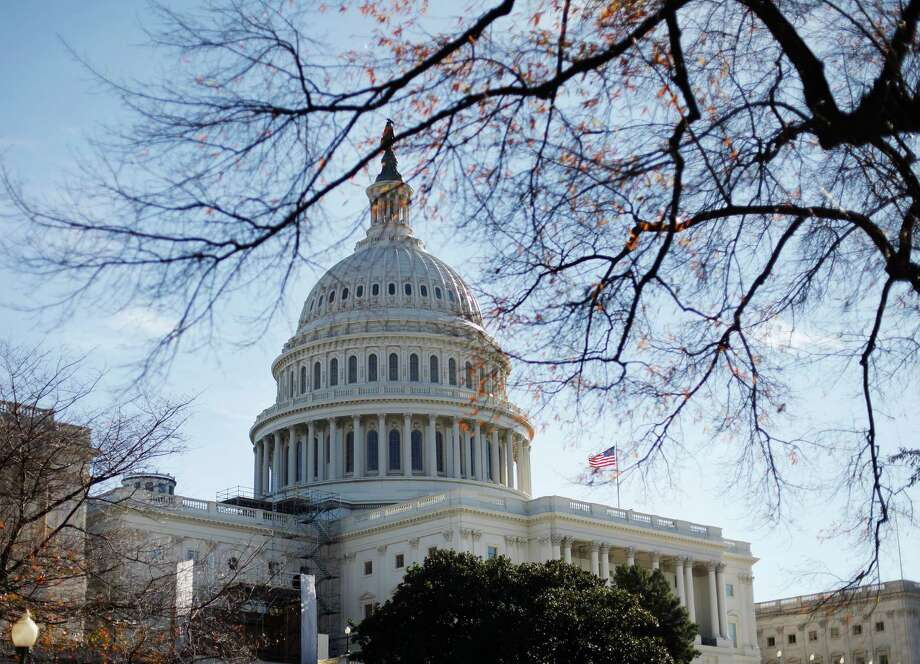FILE - In this Nov. 19, 2011 fie photo the U.S. Capitol building is seen in Washington. Fresh off a five-week vacation, lawmakers return to Washington on Monday, Sept. 10, 2012, for a brief pre-election session in which Congress will do what it often does best: punt its problems to the future. At issue is a six-month temporary spending bill to finance the day-to-day operations of the federal government.  (AP Photo/Pablo Martinez Monsivais, File) Photo: Pablo Martinez Monsivais, Associated Press / AP