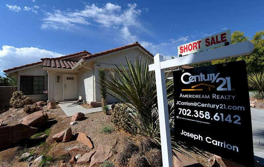 (FILES)A short sale home in the Spring Valley area in Las Vegas is viewed in this October 15, 2010 file photo.  Prices for US homes fell again in November, a key index showed Tuesday, failing to respond to record low mortgage loan rates. Prices fell from October by a seasonally adjusted 0.7 percent, according to the S&P-Case-Shiller index for 20 top metropolitan areas, after an identical 0.7 percent drop the previous month.  The only gains were made in Phoenix, Arizona and Denver, Colorado, both very hard hit in the post-2005 housing market crash. AFP PHOTO/Mark RALSTON (Photo credit should read MARK RALSTON/AFP/Getty Images) Photo: Mark Ralston, AFP/Getty Images
