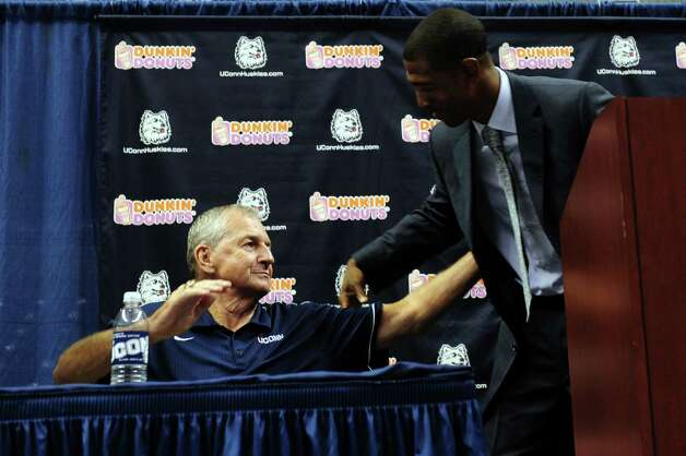 Former University of Connecticut Coach Jim Calhoun and Kevin Ollie, who was named UConn's 18th head coach, hug during a media conference at Harry A.Gampel Pavilion in Storrs, Conn. on Thursday, Sept. 13, 2012. Photo: Autumn Driscoll / Connecticut Post