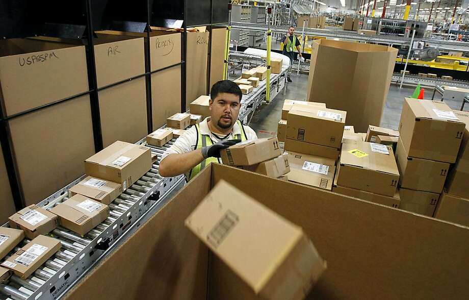 Amazon is one of the online retailers that will be charging sales tax starting Saturday. Photo: Ross D. Franklin, Associated Press