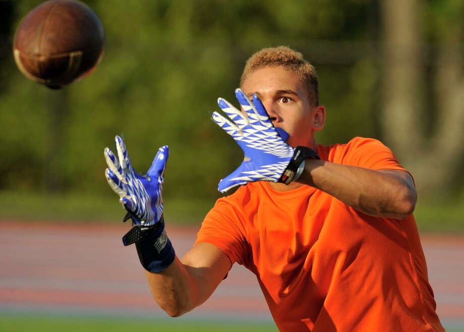 Corey Chaffee catches the ball during Danbury High School football practice on Wednesday, Aug. 22, 2012. Photo: Jason Rearick / The News-Times