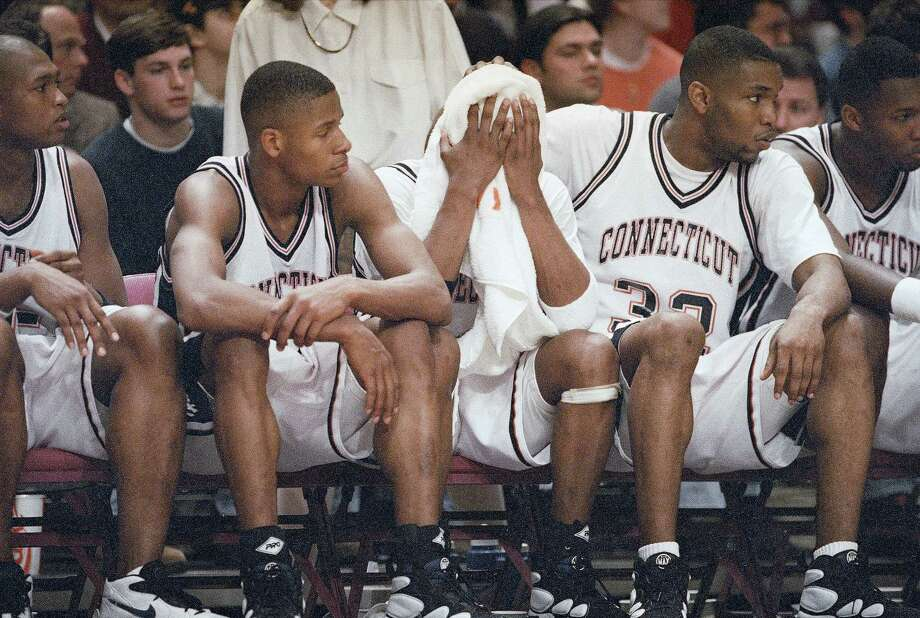 Connecticut's Ray Allen, left, Kevin Ollie and Kirk King, right, watch glumly from the bench as they lose to Villanova in the Big East Tournament final at New York?s Madison Square on Sunday, March 12, 1995. Villanova won 94-78. Photo: Bill Kostroun,  (AP Photo/Bill Kostroun) / Associated Press