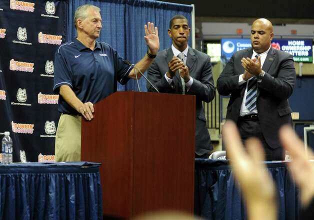 University of Connecticut Coach Jim Calhoun announces his retirement after 26 years during a media conference at Harry A.Gampel Pavilion in Storrs, Conn. on Thursday, Sept. 13, 2012.  Kevin Ollie, who was named UConn's 18th head coach, and Athletic Director Warde Manuel applaud. Photo: Autumn Driscoll / Connecticut Post
