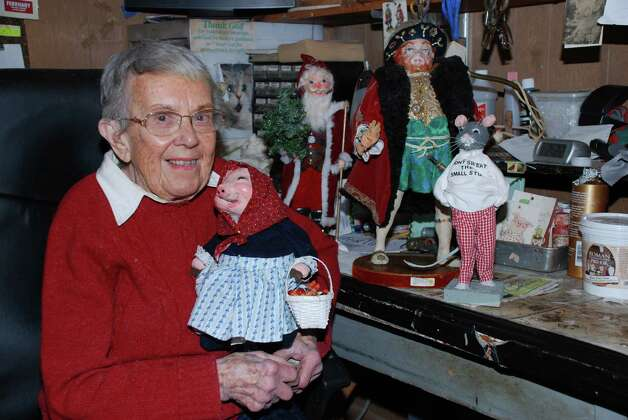 "Norwalk resident Trudy Gilbert poses among some of her papier-mache figurines. A lifetime member of the Rowayton Arts Center, Gilbert will be displaying some of her work through September as part of the exhibition ""Ageless Art,"" at the center's Portside Gallery, 145 Rowayton Ave., in the Rowayton section of Norwalk, Conn.. A public reception is set for Sunday, Sept. 9, from 3 to 4 p.m. For more information, call 203-866-2744, or visit www.rowaytonartscenter.org. Photo: Contributed Photo"