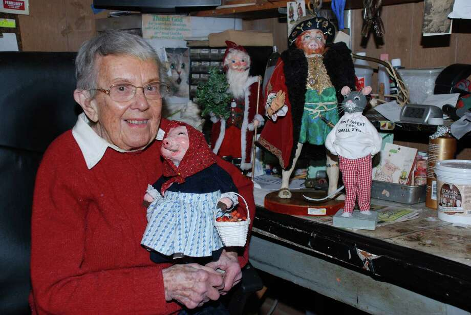 """Norwalk resident Trudy Gilbert poses among some of her papier-mache figurines. A lifetime member of the Rowayton Arts Center, Gilbert will be displaying some of her work through September as part of the exhibition """"Ageless Art,"""" at the center's Portside Gallery, 145 Rowayton Ave., in the Rowayton section of Norwalk, Conn.. A public reception is set for Sunday, Sept. 9, from 3 to 4 p.m. For more information, call 203-866-2744, or visit www.rowaytonartscenter.org. Photo: Contributed Photo"""