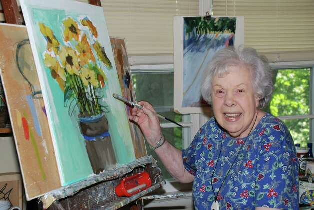 "Edith McClean, a resident of the Rowayton section of Norwalk, works on one of her acrylic paintings that is representative of the work she will be displaying at ""Ageless Art,"" a new exhibition set to run through September at the Rowayton Arts Center, 145 Rowayton Ave., in the Rowayton section of Norwalk, Conn.. A public reception is set for Sunday, Sept. 9, from 3 to 4 p.m. For more information, call 203-866-2744, or visit www.rowaytonartscenter.org. Photo: Contributed Photo"
