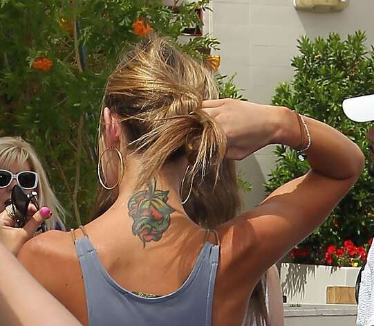 Former Hills star Audrina Patridge has a colorful neck tattoo of a snake wrapped around a strawberry heart.