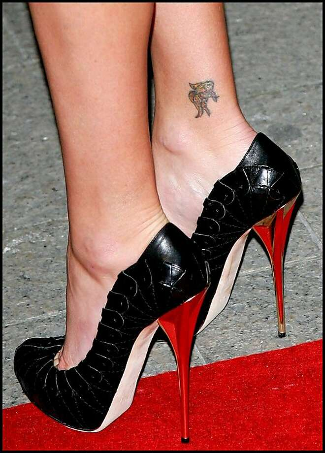 Oscar winner Charlize Theron has a tiny koi fish on her ankle.