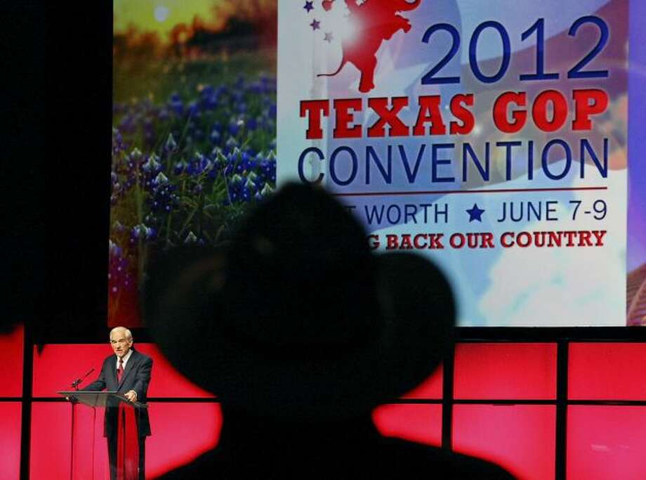 A Ron Paul fan in a cowboy hat gives his candidate a standing ovation at the 2012 Texas Republican state convention in Fort Worth.