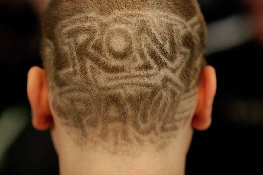 Justin Roy, 22, of Springfield, MA, shows off his haircut in support of Republican presidential candidate Ron Paul after a campaign town hall meeting at the Church Landing at Mill Falls January 8, 2012 in Meredith, N.H. Photo: Chip Somodevilla, Getty Images / 2012 Getty Images