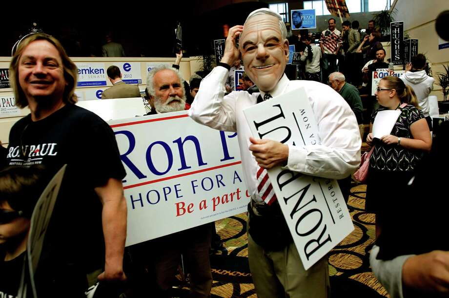 Donald Barsell of Ben Lomond, Ca., a supporter of presidential candidate Ron Paul wears a mask of his candidate on day two of the California Republic Party State Convention on Saturday Feb. 25, 2012, in Burlingame, Ca. Photo: Michael Macor, SFC / ONLINE_YES