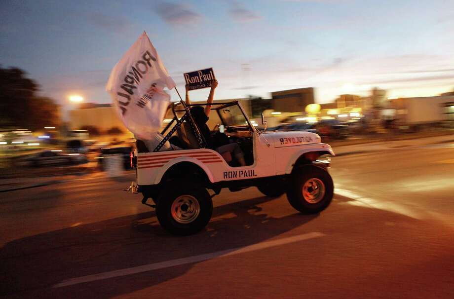 Supporters of Rep. Ron Paul drive a decorated Jeep down USF Holly Drive before the GOP presidential debate sponsored by NBC News, National Journal and the Tampa Bay Times at the University of South Florida January 23, 2012 in Tampa, Florida. Photo: Chip Somodevilla, Getty Images / 2012 Getty Images