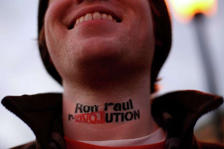 Landon Cook of Boston, Mass., wears an imitation tattoo on his neck in support of Ron Paul outside a scheduled event for Republican presidential candidate, former Massachusetts Gov. Mitt Romney, at the Pinkerton Academy Saturday morning, Jan. 7, 2012, in Derry, N.H. Photo: Matt Rourke, Associated Press / AP