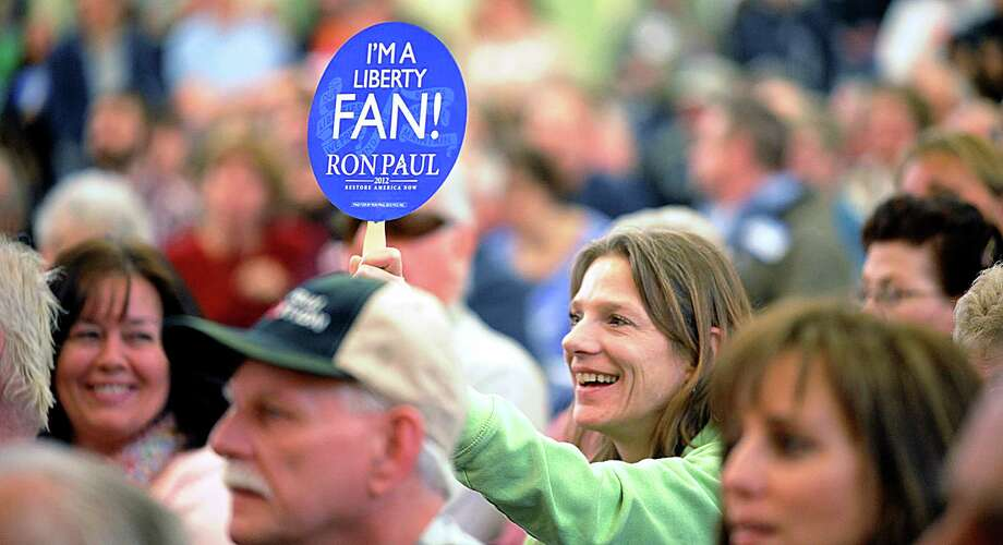 Victoria Forbis, from Lewiston, Maine, holds up a sign during a speech by Republican presidential candidate Ron Paul at Geiger Elementary School in Lewiston, Maine, on Saturday, Feb.  11, 2012, during Androscoggin County's Republican caucus. Photo: Amber Waterman, Associated Press / SUN JOURNAL