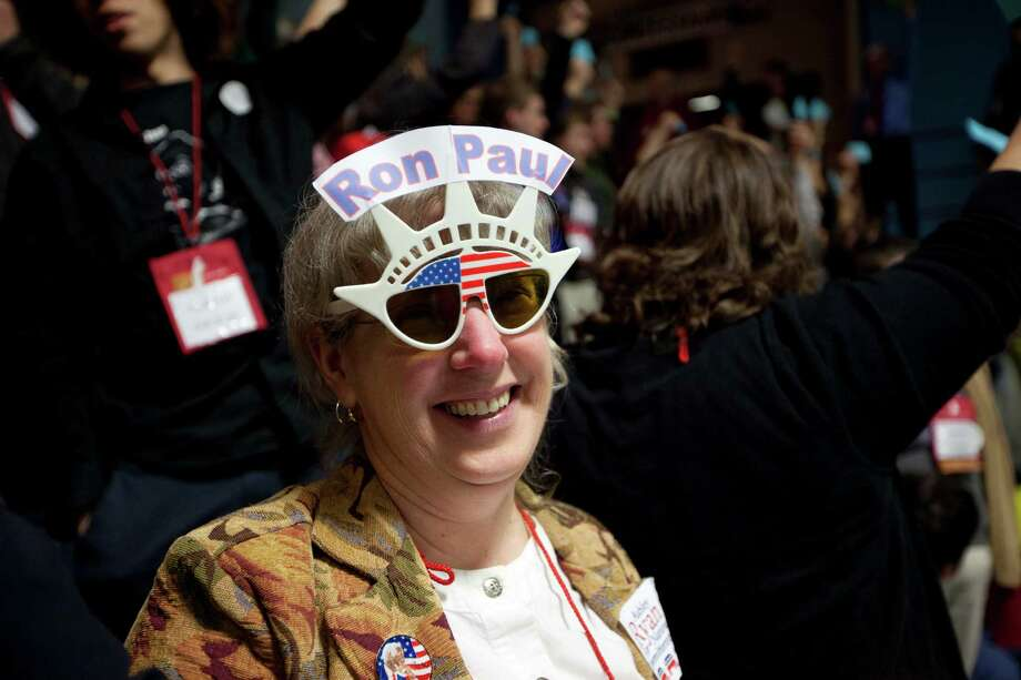 Linda Silvia, of China, Maine, and a delegate from Kennebec County,  supports presidential candidate  Ron Paul during the Maine Republican Convention at the Augusta Civic Center in Augusta, Maine, Saturday, May 5, 2012. Photo: Robert F. Bukaty, Associated Press / AP
