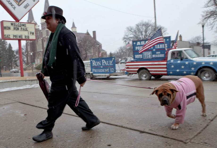 Charles Tuttle of Minot, N.D., and his mastiff dog Bella arrive in the snow for a campaign stop in Jamestown, N.D., Monday, Feb. 20, 2012, where Republican presidential candidate Ron Paul was to hold a meet and greet campaign event. Photo: Nati Harnik, Associated Press / AP