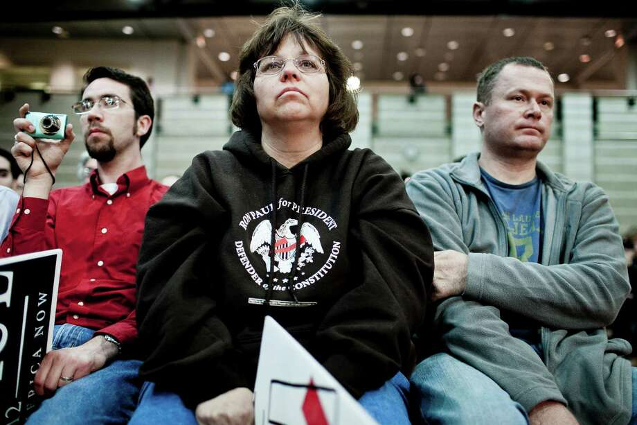 Andrew Jackson, of Seaford, Delaware, Tina Rodocker, of Seaford, Delaware, and John Elliott, of Greenwood, Delaware, listen as Ron Paul speaks during a town hall meeting at the University of Maryland on March 28, 2012 in College Park, Maryland. Photo: T.J. Kirkpatrick, Getty Images / 2012 Getty Images