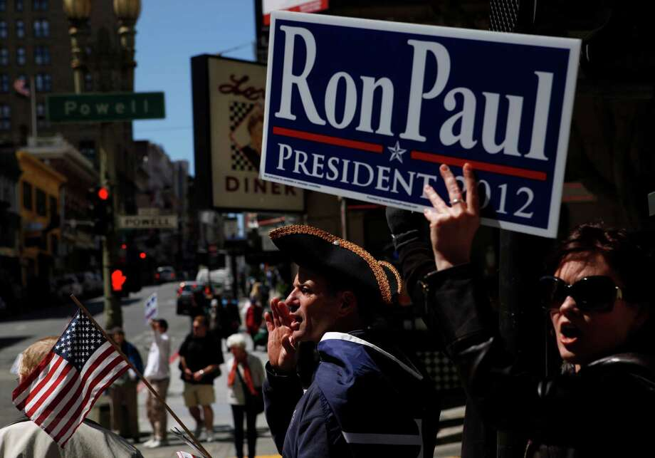 John Sharkey (left), of San Francisco,  and Ellie Black, of Santa Cruz, yell chants in support of Ron Paul outside of the Marriott Hotel on Thursday, April 5, 2011 in San Francisco, Calif. Photo: Beck Diefenbach, Special To The Chronicle / ONLINE_YES