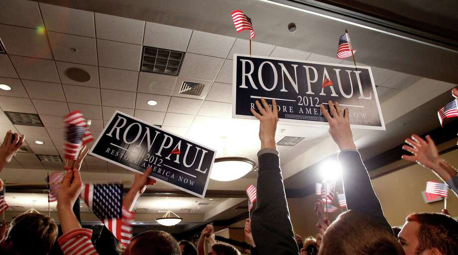Supporters cheer for Republican presidential candidate Rep. Ron Paul during his caucus night rally, Tuesday, Jan. 3, 2012, in Ankeny, Iowa. Photo: Eric Gay, Associated Press / AP
