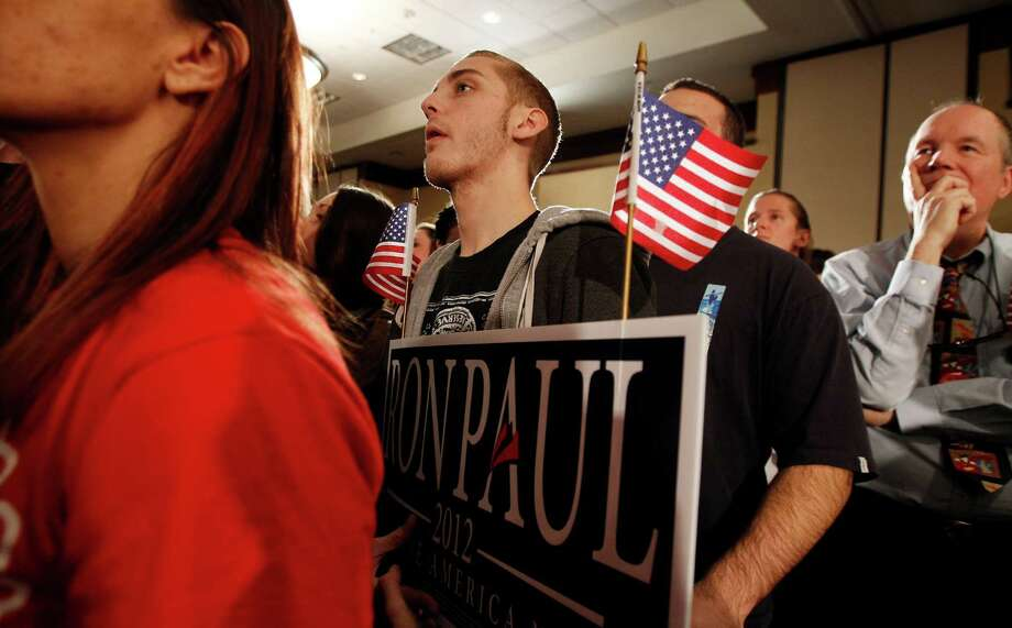 Supporters of Republican presidential candidate Ron Paul watch results during his caucus night rally, Tuesday, Jan. 3, 2012, in Ankeny, Iowa. Photo: Eric Gay, Associated Press / AP