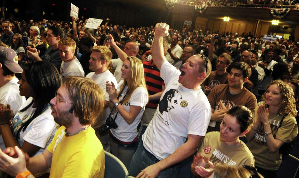 Supporters cheer for Ron Paul at Soldier & Sailors Memorial Hall Friday night, April 20, 2012 in Pit