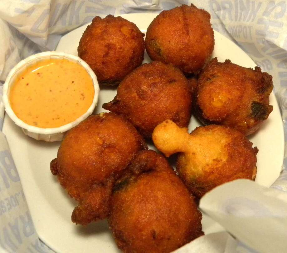 STEVE BARNES/TIMES UNION  Hush puppies at Joe's Crab Shack in Latham.