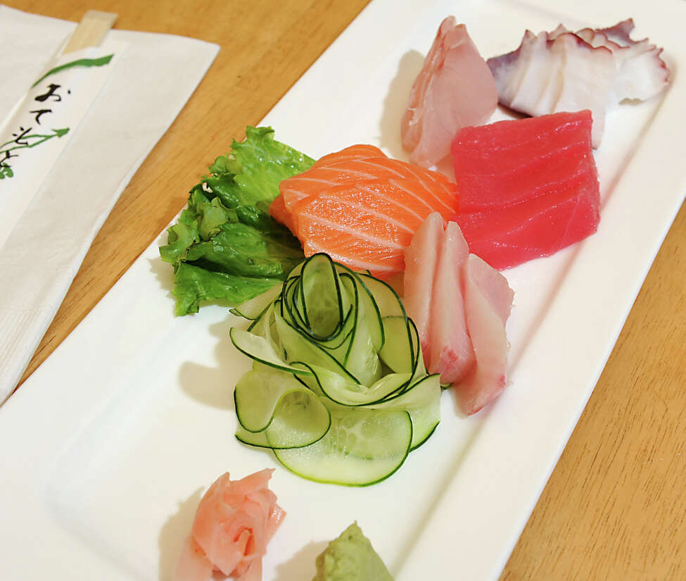 The Sashimi entree which includes 4 - tuna, 3 - white fish, 3 - salmon, 3 - yellow tail and 3 - octopus at Yoshi Sushi on Monday, Sept. 10, 2012 in Latham, N.Y. (Lori Van Buren / Times Union)