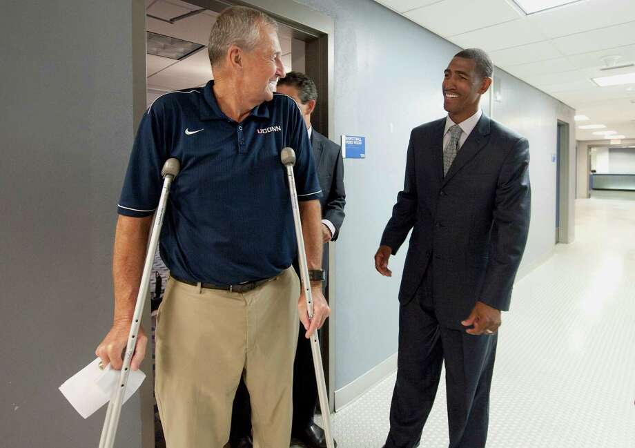 Jim Calhoun (left), who officially retired as Connecticut's men's basketball coach after 873 wins, three national titles and several health scares, will be replaced by one of his former players, Kevin Ollie. Photo: Jessica Hill, Associated Press / FR125654 AP