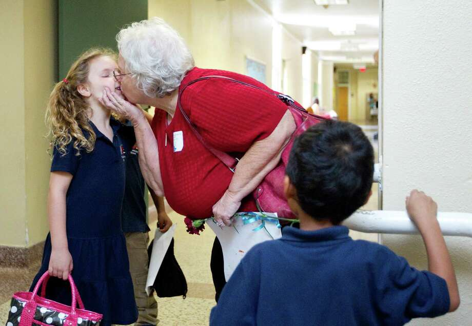 "Patricia Seymour, ""Nana,"" said goodbye to  granddaughter Brooke Collins, 6, after they had lunch together and visited during Poe Elementary School's grandparents day on Thursday, Sept. 13. Photo: Johnny Hanson, Houston Chronicle / © 2012  Houston Chronicle"