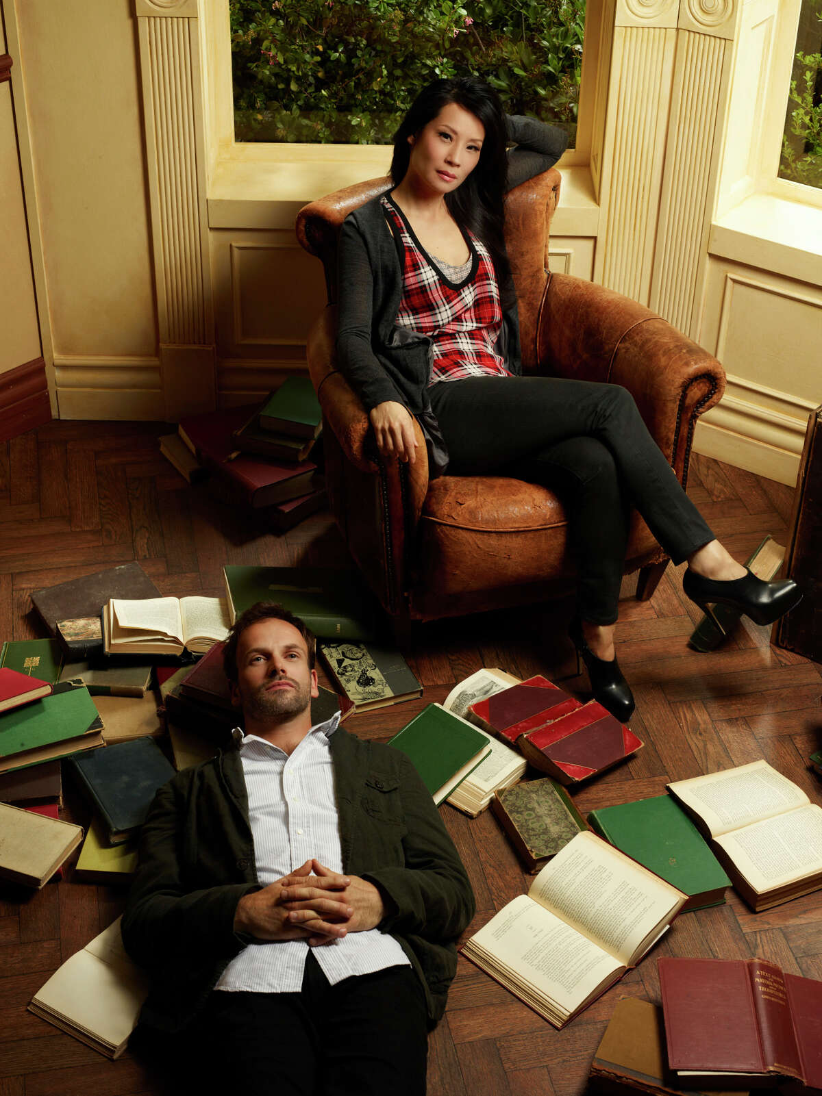 Jonny Lee Miller (left) stars as Sherlock Holmes and Lucy Liu (right) stars as Watson on the new television series ELEMENTARY, premiering Thursdays, 10pm ET/PT this Fall on the CBS Television Network. Photo: Nino Munoz/CBS©2012 CBS Broadcasting Inc. All Rights Reserved.
