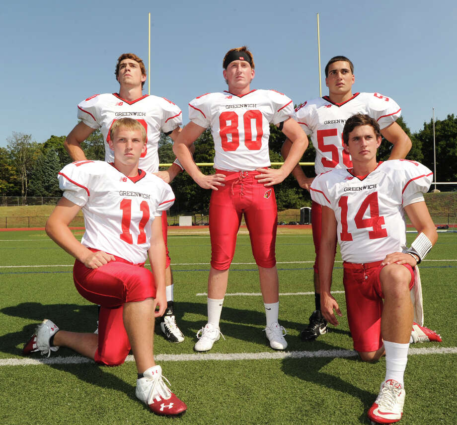 Greenwich High School football captains standing from left, Taylor Olmstead, Joe Kelly and Alex McGee, kneeling from left, Alex McMurray and Liam O'Neil, during photo day for the Greenwich High School football team at the school, Friday, Aug. 31, 2012. Photo: Bob Luckey / Greenwich Time