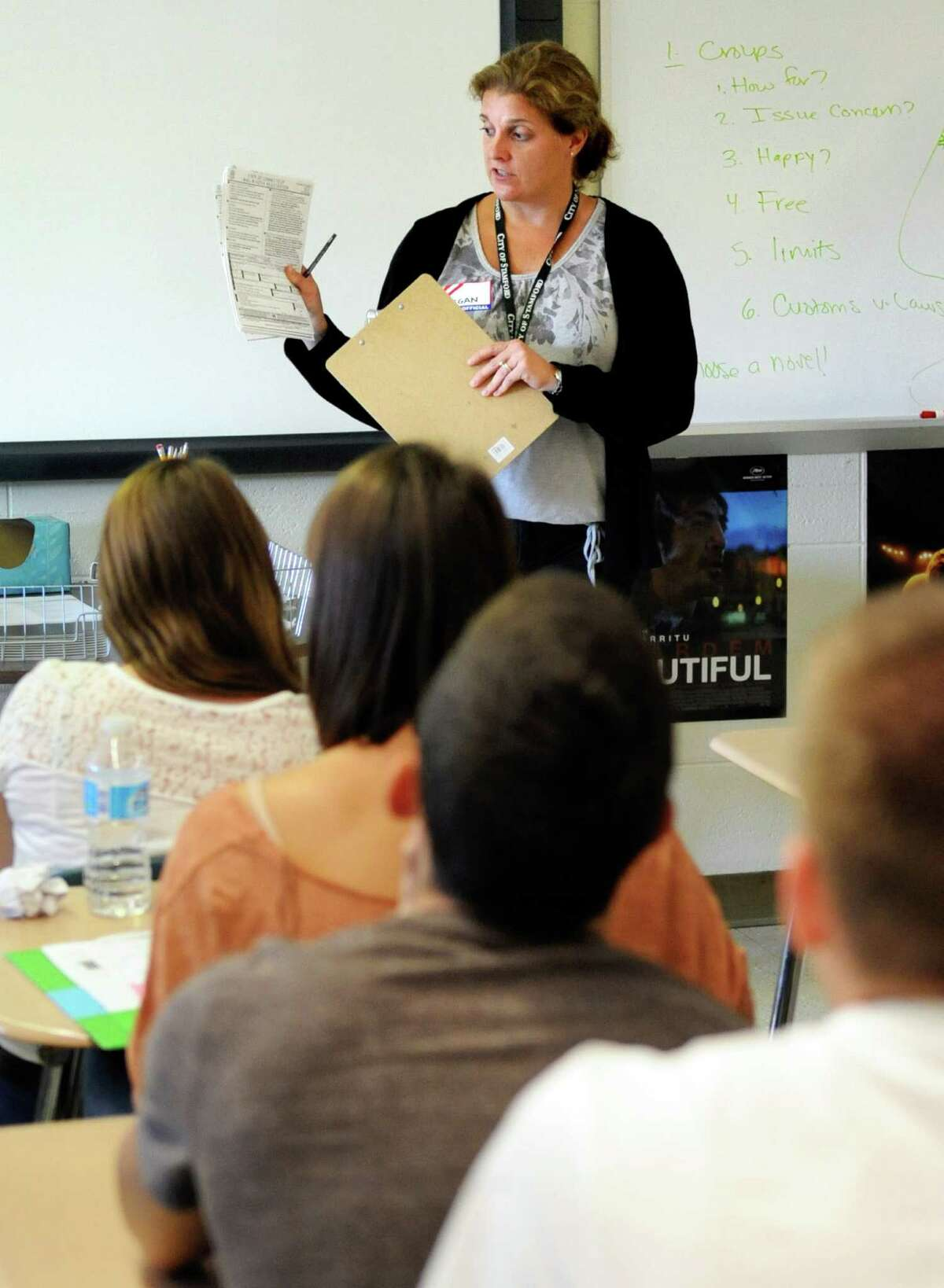Regan Allan, seasonal employee at the Democratic Registrar of Voters, speaks to a class at Westhill High School on Thursday, September 13, 2012, to provide students the opportunity to register to vote.