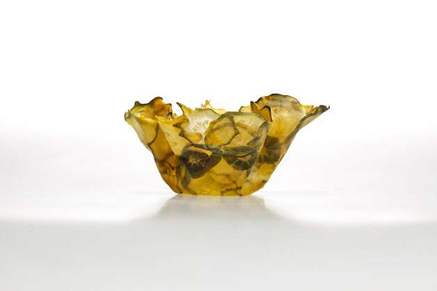 Margaret Dorfman's bowls made from fruit and vegetable parchment, from top: beet; purple and white potato; cantaloupe; yellow scallop squash. Photo: Russell Yip, The Chronicle