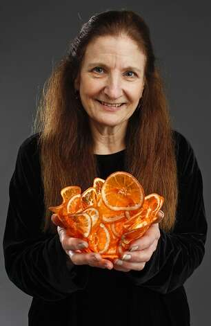 Artist Margaret Dorfman, with citrus bowl, studied anthropology at UC Davis, which included insights into cultures that created items out of vegetation. Photo: Russell Yip, The Chronicle