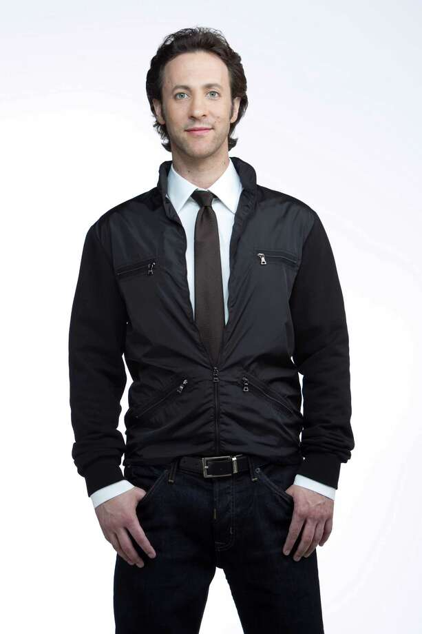 "David Eagleman, a neuroscientist at Baylor College of Medicine wears Prada jacket ($585), Gucci brown silk tie ($180), Prada white shirt ($420), Zegna belt ($225) and Hudson ""Barton"" jeans ($165), all from Neiman Marcus. Styling by Todd Ramos, hair/makeup by Tree Vaello. Photographed Friday, July 15, 2011, in the Chronicle studio in Houston.  ( Nick de la Torre / Houston Chronicle ) Photo: Nick De La Torre / © 2010 Houston Chronicle"
