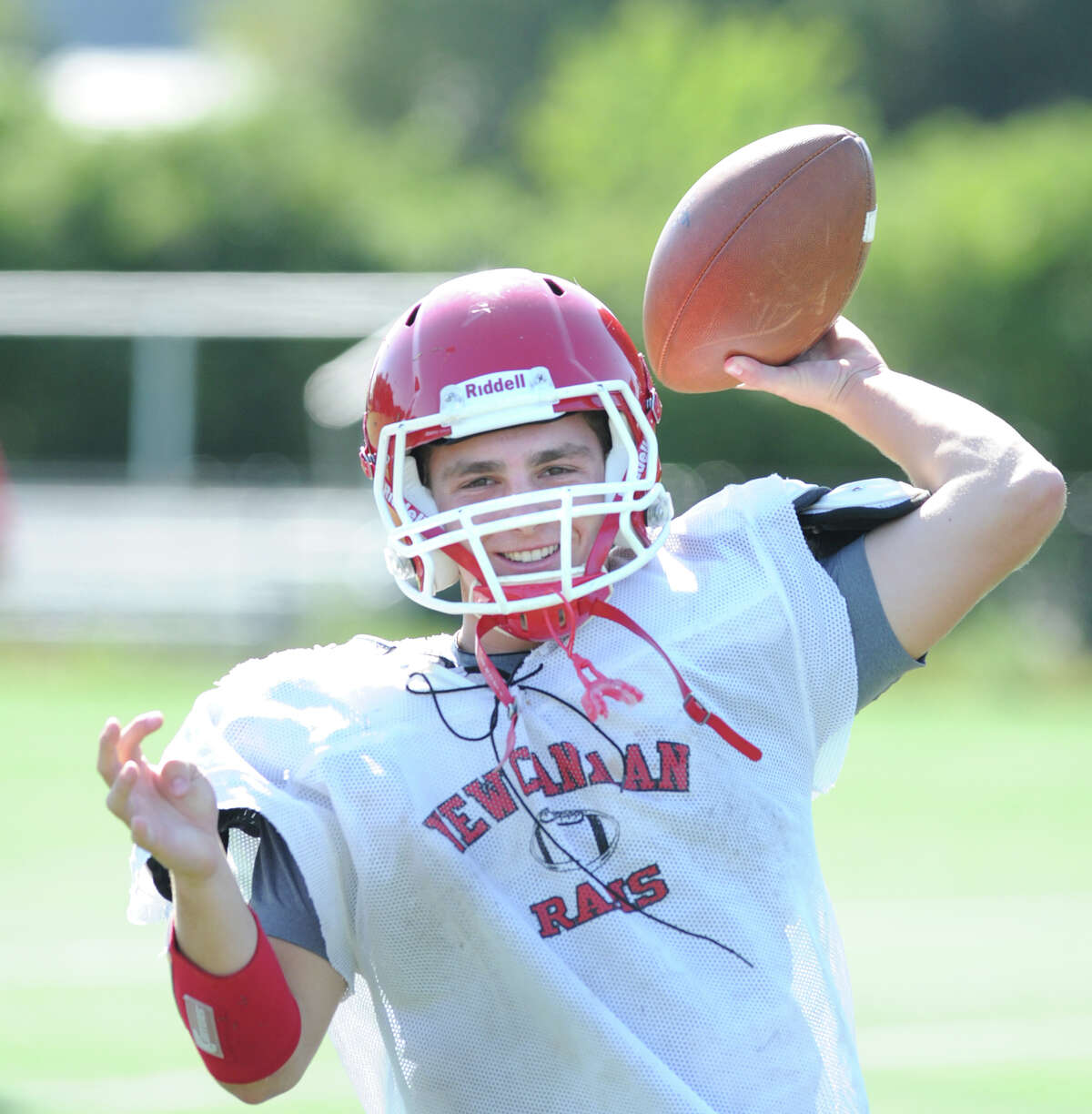 New Canaan High School Football quarterback and wide receiver, Teddy Bossidy, a junior, during football practice at the school, Wednesday, Sept. 12, 2012.