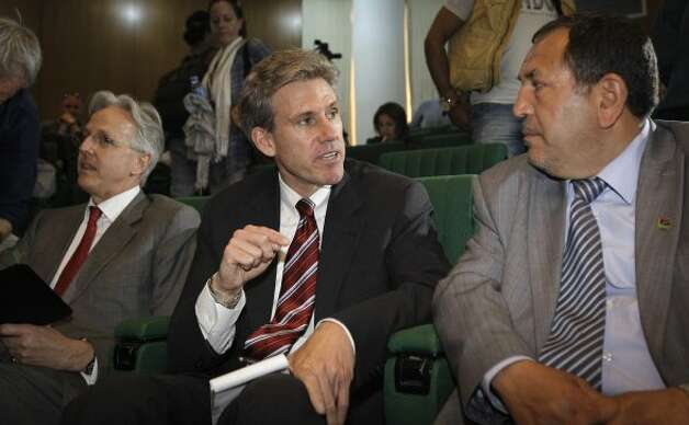 In this photo taken Monday, April 11, 2011, then U.S. envoy Chris Stevens, center, accompanied by British envoy Christopher Prentice, left, speaks to Council member for Misrata Dr. Suleiman Fortia, right, at the Tibesty Hotel where an African Union delegation was meeting with opposition leaders in Benghazi, Libya. Libyan officials say the U.S. ambassador and three other Americans have been killed in an attack on the U.S. consulate in the eastern city of Benghazi by protesters angry over a film that ridiculed Islam's Prophet Muhammad. (AP Photo/Ben Curtis) (Ben Curtis / Associated Press)