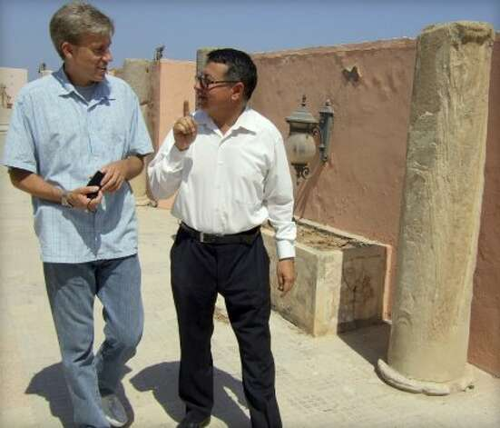 In this photo posted on the U.S. Embassy Tripoli Facebook page on Aug. 27, 2012, U.S. Ambassador to Libya Christopher Stevens, left, walks with an unidentified translator during a tour of Assaraya al-Hamra, or the Red Castle in Tripoli, Libya. Libyan officials say the U.S. ambassador and three other Americans have been killed in an attack on the U.S. consulate in the eastern city of Benghazi by protesters angry over a film that ridiculed Islam's Prophet Muhammad. (AP Photo/U. S. Embassy Tripoli) (Anonymous / Associated Press)