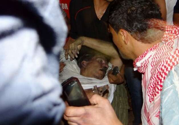 Libyan civilians help an unconscious man, identified by eyewitnesses as US ambassador to Libya Chris Stevens, at the US consulate compound in Benghazi in the early hours of September 12, 2012, following an overnight attack on the building. Stevens and three of his colleagues were killed in an attack on the US consulate in the eastern Libyan city by Islamists outraged over an amateur American-made Internet video mocking Islam, less than six months after being appointed to his post. (- / AFP/Getty Images)