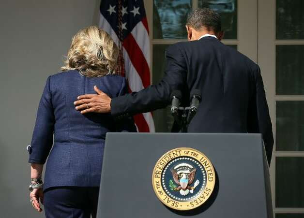 U.S. President Barack Obama (R) and Secretary of State Hillary Clinton (L) leave after a statement in response to the attack at the U.S. Consulate in Libya September 12, 2012 at the Rose Garden of the White House in Washington, DC. U.S. Ambassador J. Christopher Stevens and three other Americans were killed in an attack on the U.S. Consulate in Benghazi, Libya by protesters who were potentially angry over a controversial Prophet Muhammad video. (Alex Wong / Getty Images)