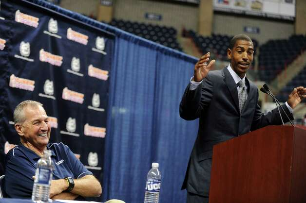 Former University of Connecticut Coach Jim Calhoun listens as Kevin Ollie, who was named UConn's 18th head coach, addresses the media at Harry A. Gampel Pavilion in Storrs, Conn. on Thursday, Sept. 13, 2012. Photo: Autumn Driscoll / Connecticut Post