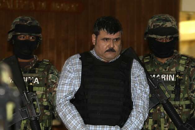 Mexican navy marines escort alleged cartel leader Jorge Eduardo Costilla Sanchez after his arrest. Photo: Dario Lopez-Mills, Associated Press