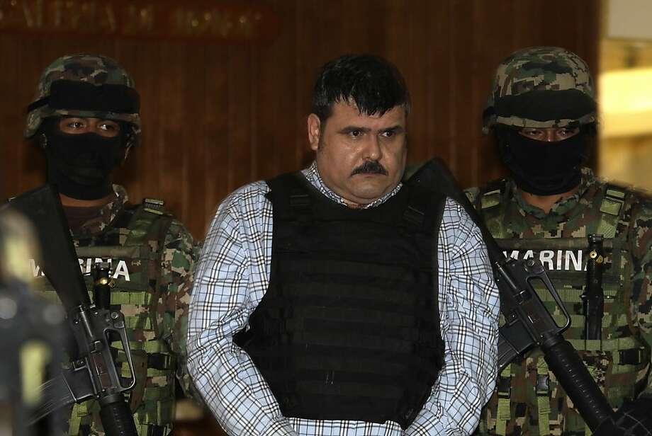 Mexican navy marines escort alleged cartel leader Jorge Eduardo Costilla Sanchez after his arrest. Photo: Dario Lopez-Mills, Associated Press
