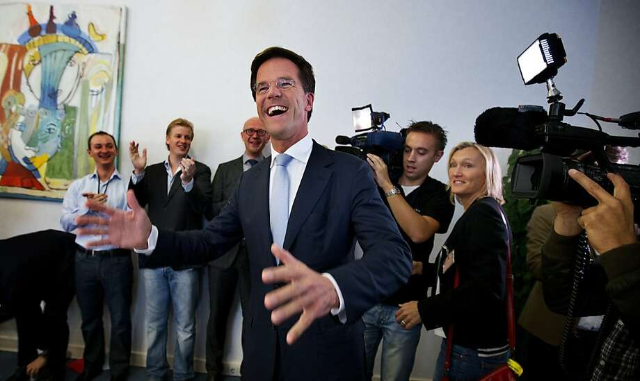 Mark Rutte, Dutch prime minister and leader of the liberal VVD party, is applauded by supporters. Photo: Jerry Lampen, AFP/Getty Images