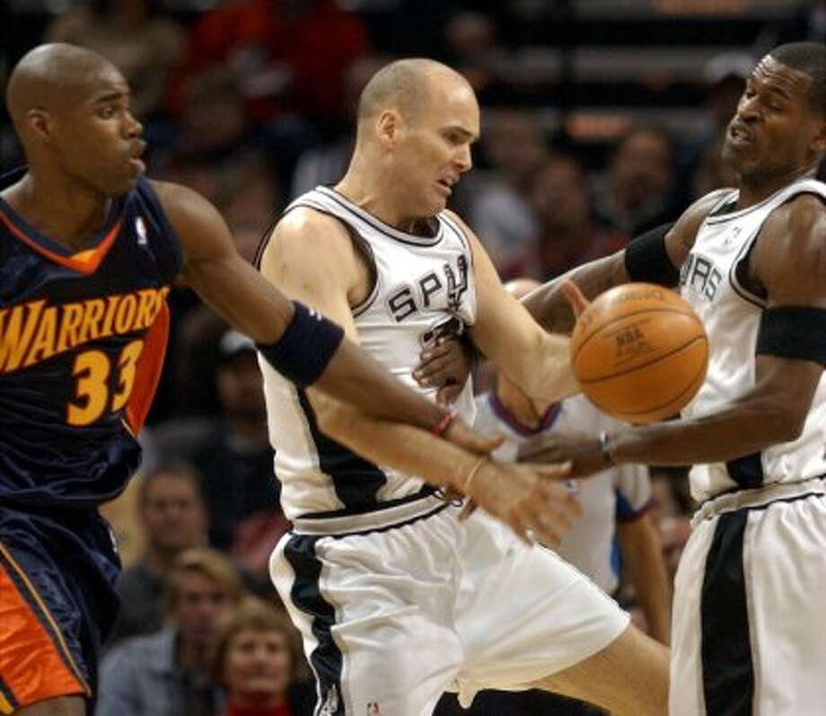 Danny Ferry (center), Hawks: Played three seasons, 2000-03; director of basketball operations, 2003-05; VP of basketball operations, 2010-12 (BAHRAM MARK SOBHANI / SAN ANTONIO EXPRESS-NEWS)