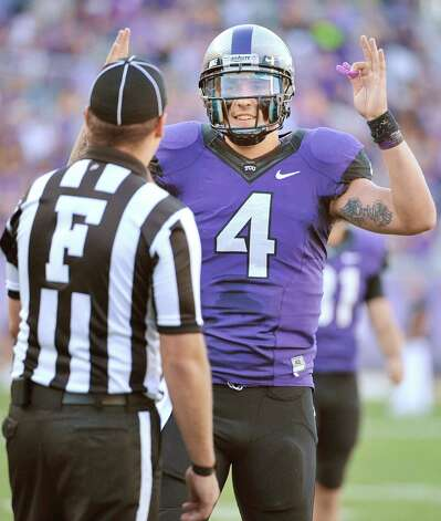 Texas Christian quarterback Casey Pachall (4) celebrates a 1-yard TD run by running back Waymon James during the first quarter against Grambling State at Amon G. Carter Stadium in Fort Worth, Texas, on Saturday, September 8, 2012. (Max Faulkner/Fort Worth Star-Telegram/MCT) Photo: Max Faulkner, McClatchy-Tribune News Service / Fort Worth Star-Telegram